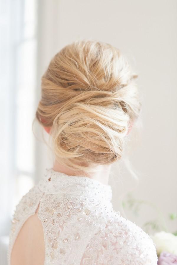Tousled low bun wedding hairstyle