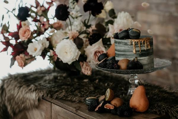 Grey wedding cake decorated with autumn fruits