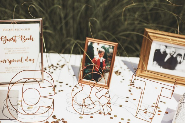 Copper wire initials on wedding guest book table