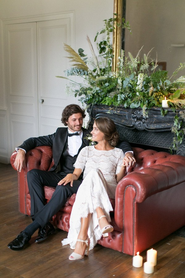 Bride and groom sitting on couch at Chateau de Redon
