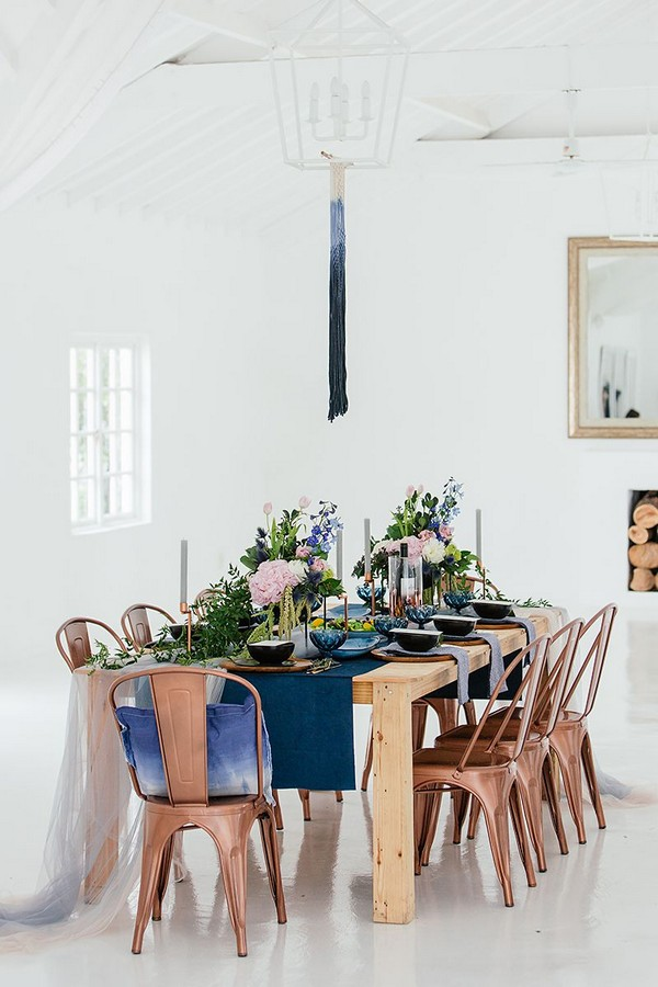Table with blue and copper wedding styling
