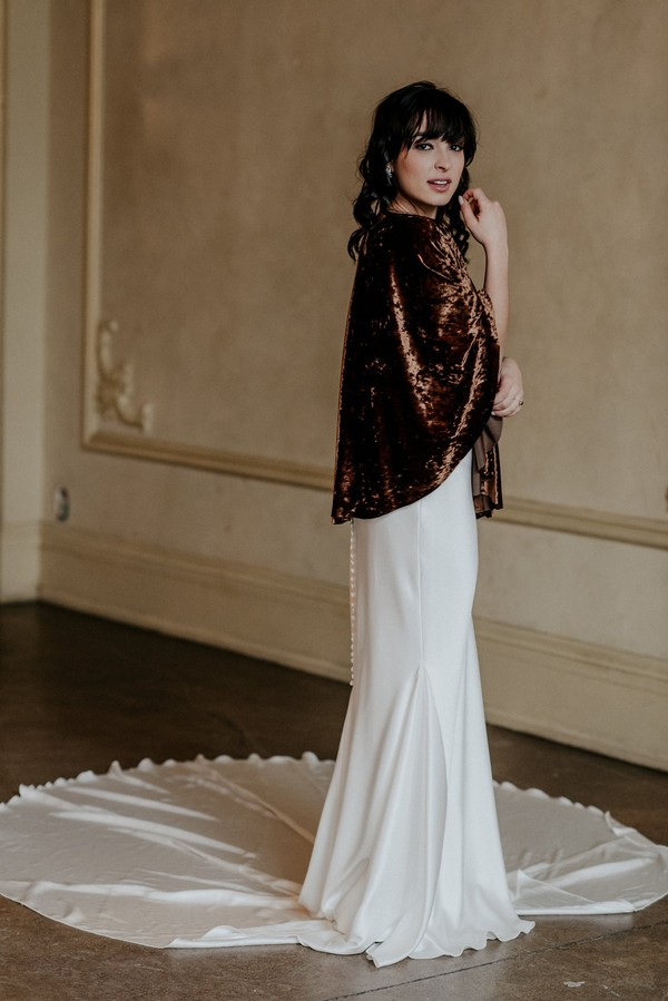 Bride wearing velvet shrug