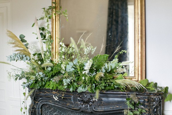 Mantelpiece decorated in foliage