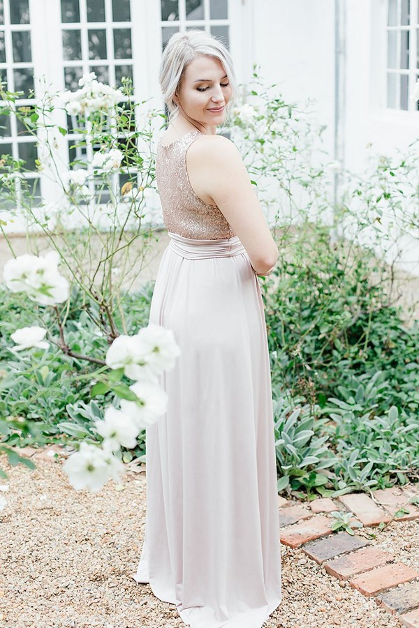 Bridesmaid wearing dress with sequinned top and tulle skirt