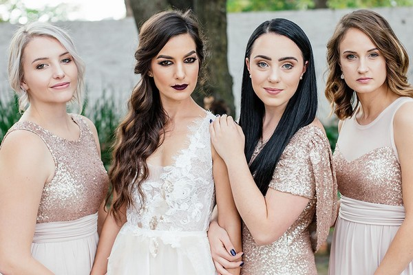 Bride with bridesmaids in sequinned detailed dresses