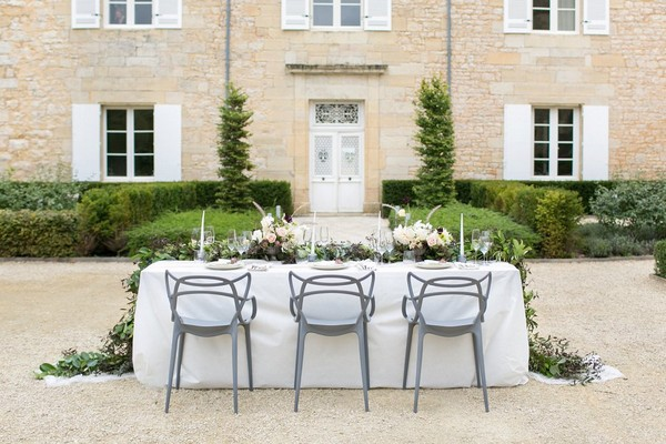 Modern grey Masters chairs at wedding table