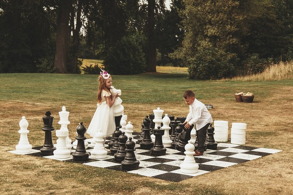 Children playing giant chess at wedding