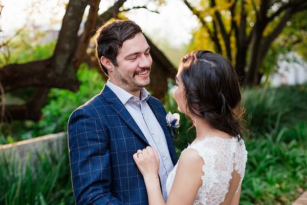 Groom smiling at bride