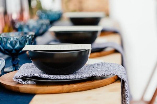 Black bowls on blue patterned napkins