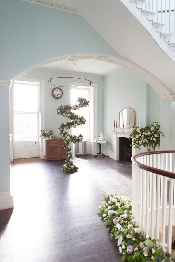 Spiral floral arrangement hanging from ceiling in Clissold House