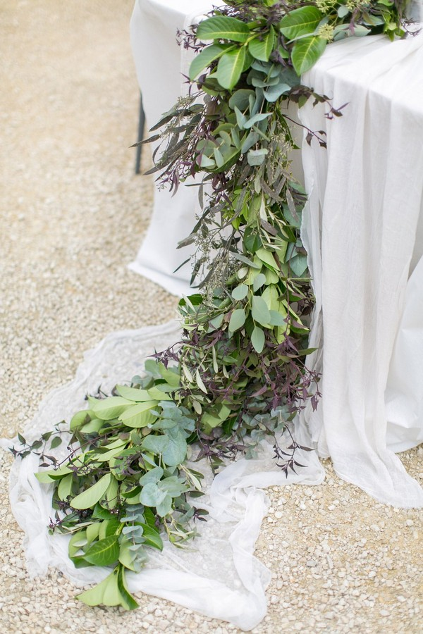 Foliage wedding table runner trailing off table