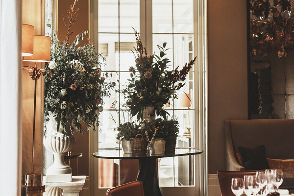 Table of potted plants at wedding
