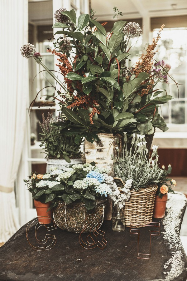 Potted plants on table at wedding