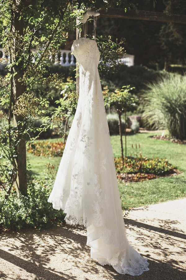 Wedding dress hanging from tree at Coworth Park