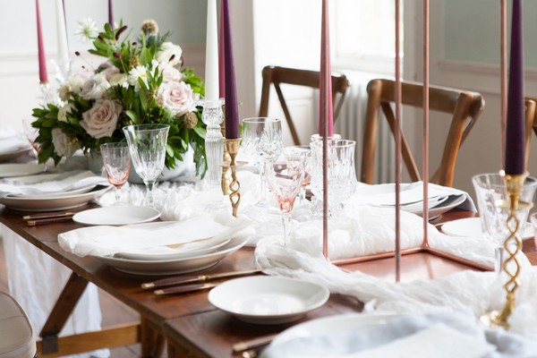 White wedding table styling on wooden table
