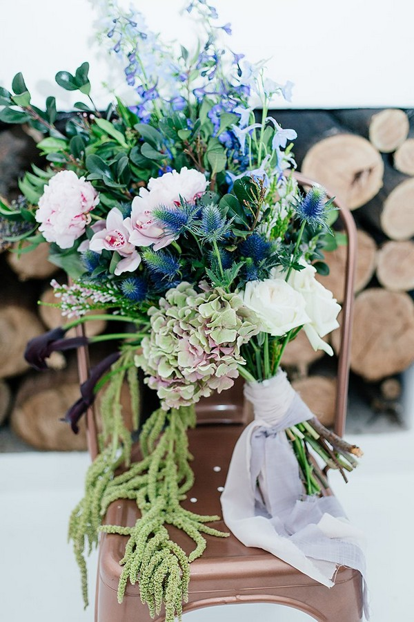Large winter wedding bouquet on copper chair
