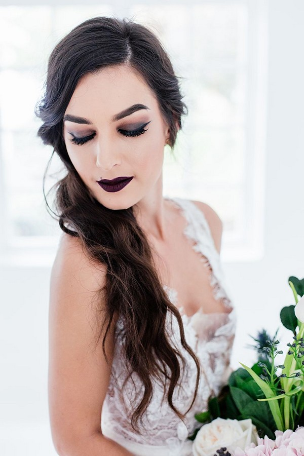 Bride with dark make-up and ponytail hairstyle