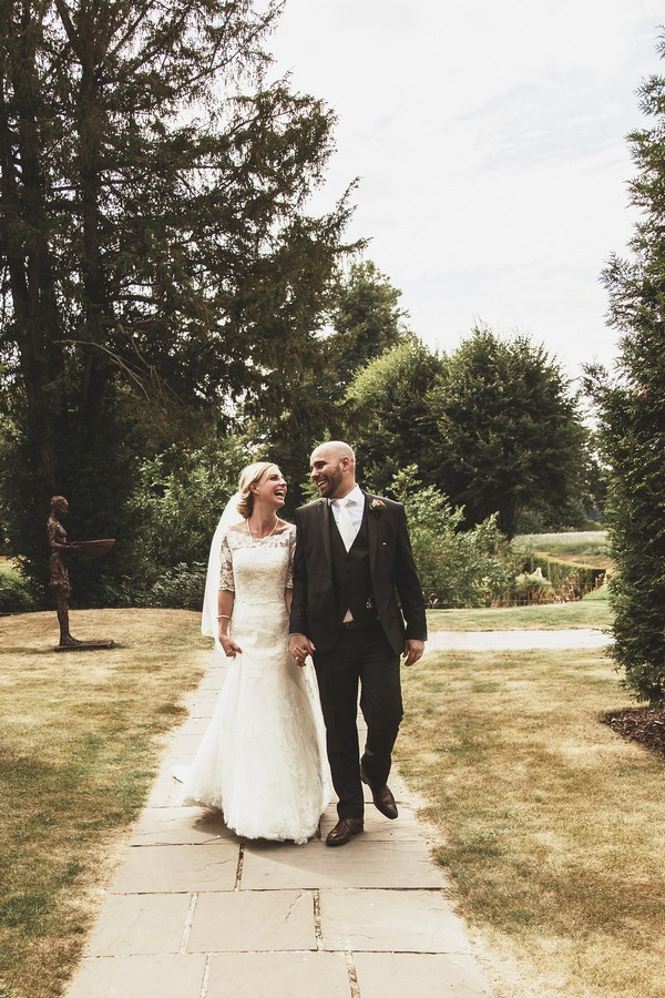 Bride and groom walking in grounds of Coworth Park