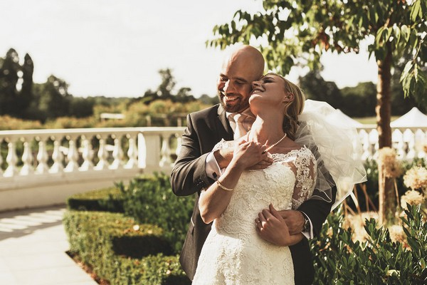 Happy bride and groom at Coworth Park