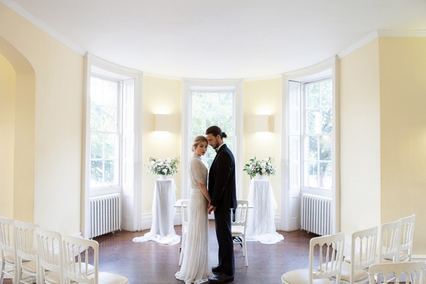 Bride and groom in wedding ceremony room at Clissold House