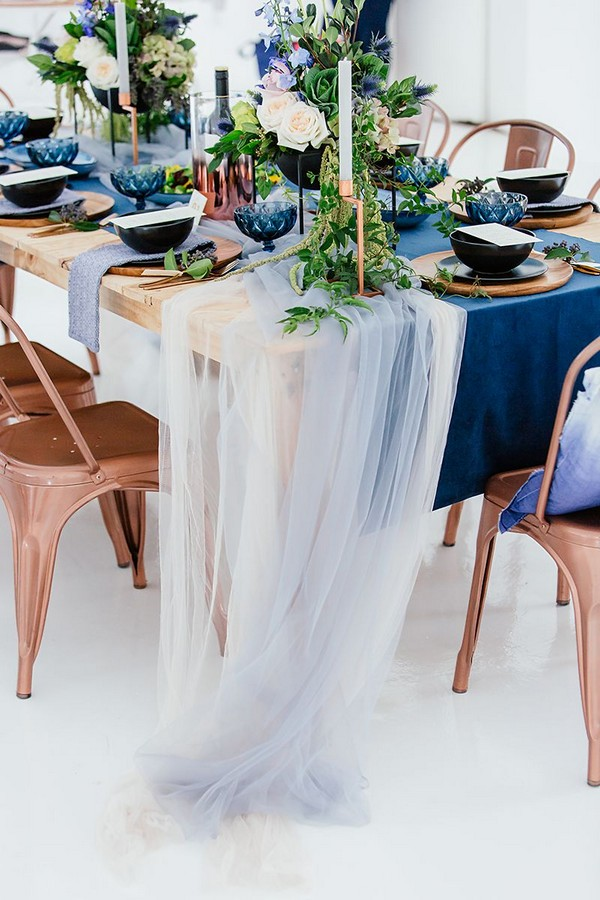 Tulle hanging from wedding table