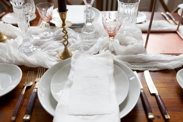 Simple white wedding place setting
