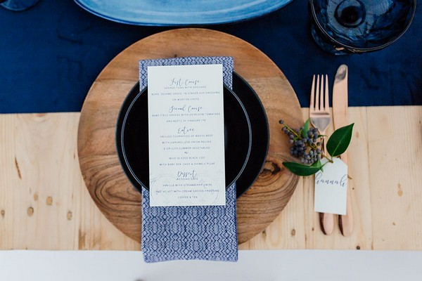 Wedding place setting with blue and black details