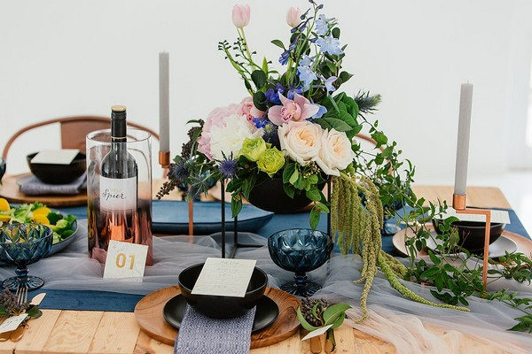 Wedding table with blue and copper details and winter flowers