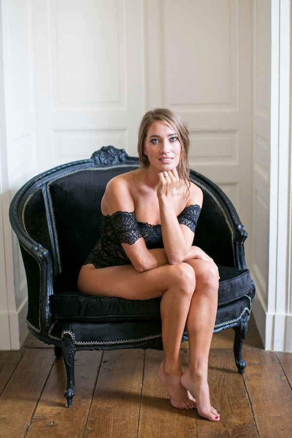 Bride sitting on chair in black lingerie