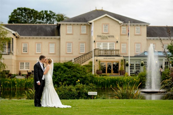 Bride and Groom Kissing Outside Spa Hotel at Ribby Hall Village