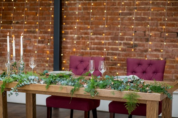 Wooden wedding table with foliage table runner