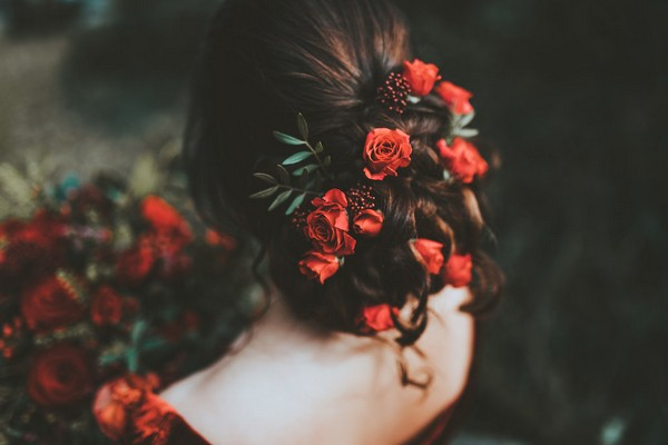 Red flowers in bride's hair