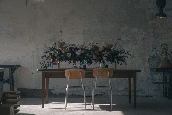 Wedding table with two chairs in warehouse