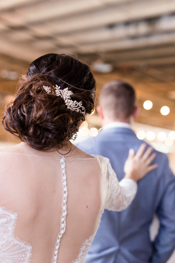 Bride touching groom on shoulder from behind