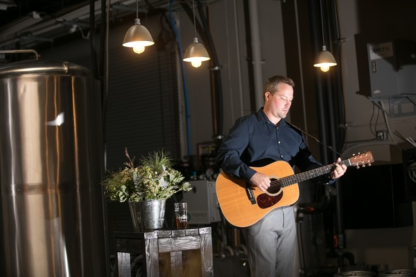 Guitarist playing at brewery wedding