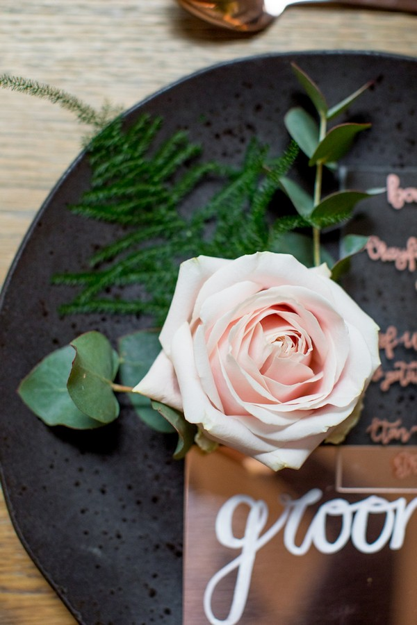 Pink rose and foliage on wedding plate