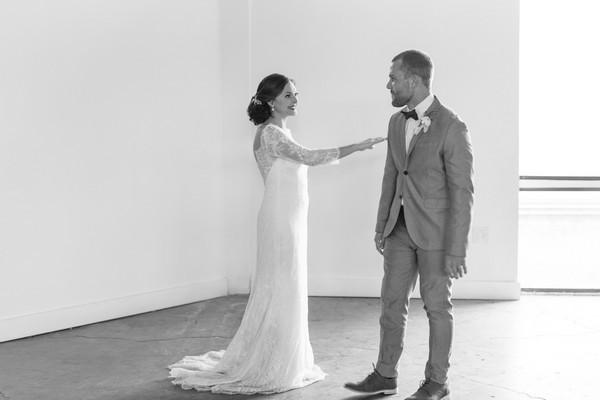 Groom turning to see bride