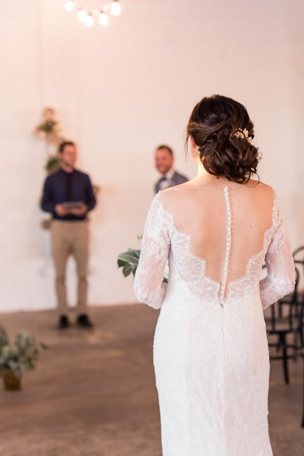 Bride walking into wedding ceremony at East Crossing