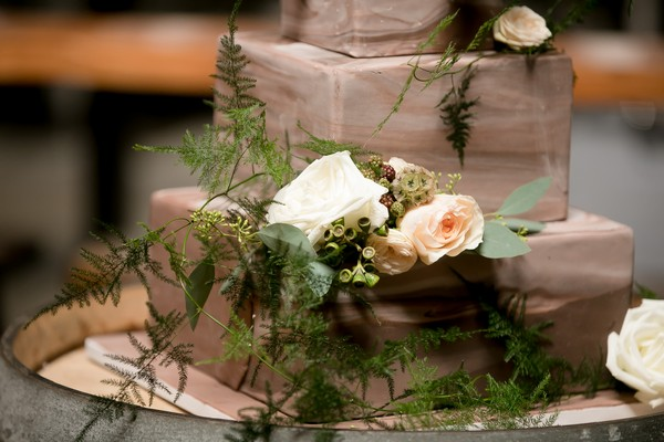 Fresh flowers on brown ombre wedding cake