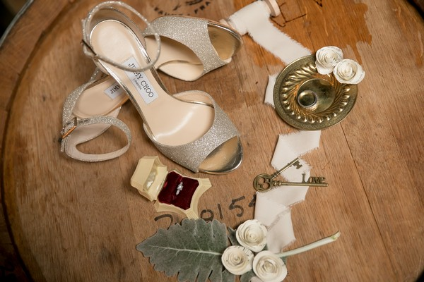 Jimmy Choo silver wedding shoes on beer barrel