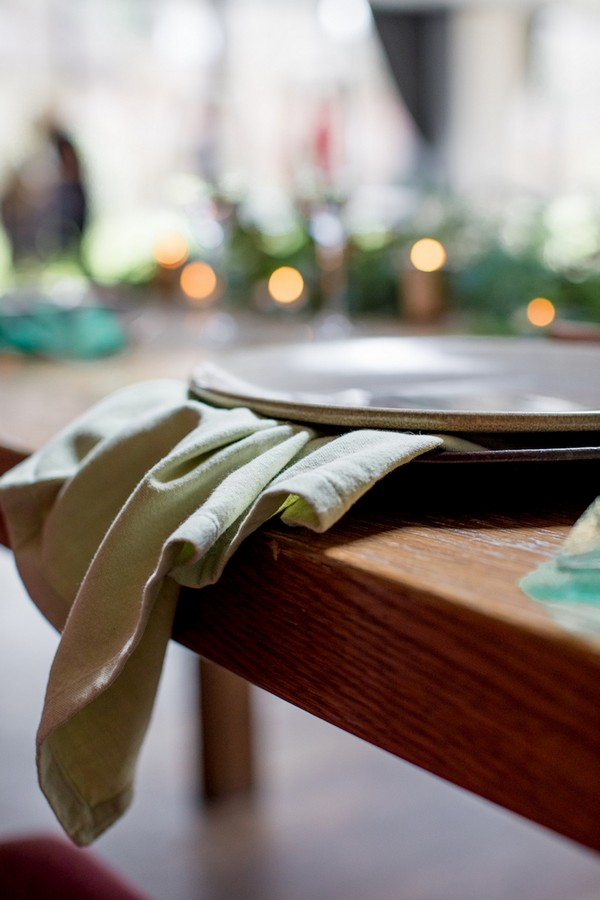 Grey wedding plate on green napkin