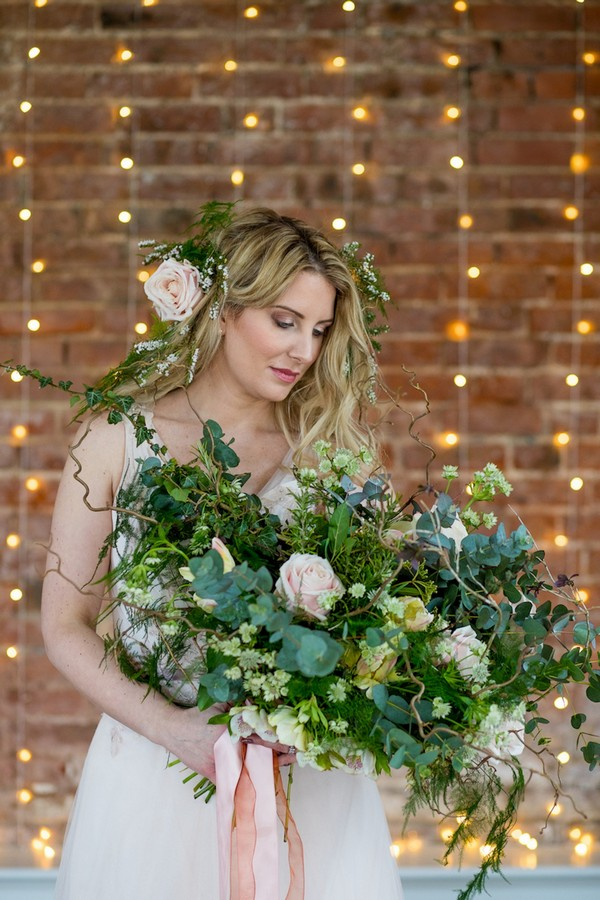 Bride holding foliage bouquet with foliage crown