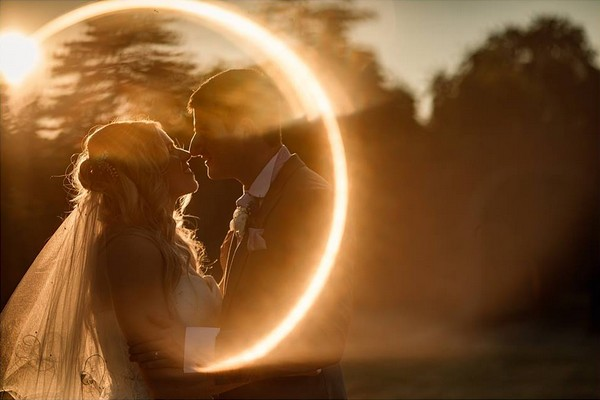 Bride and groom circled by ring of light - Picture by Becky Harley Photography