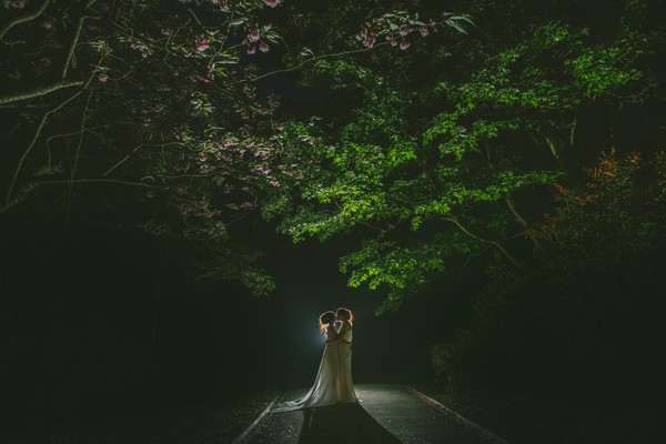 Brides kissing under tree at night - Picture by Nik Bryant Photography