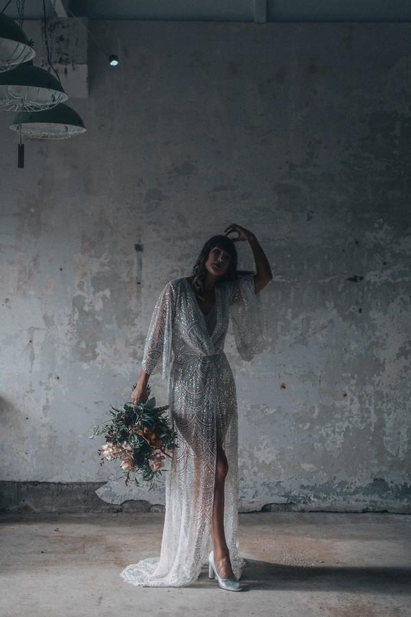 Bride wearing Gaia wedding dress in warehouse