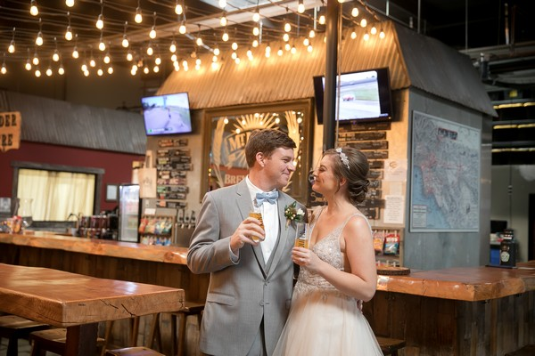 Bride and groom by bar in Mt. Lowe Brewery