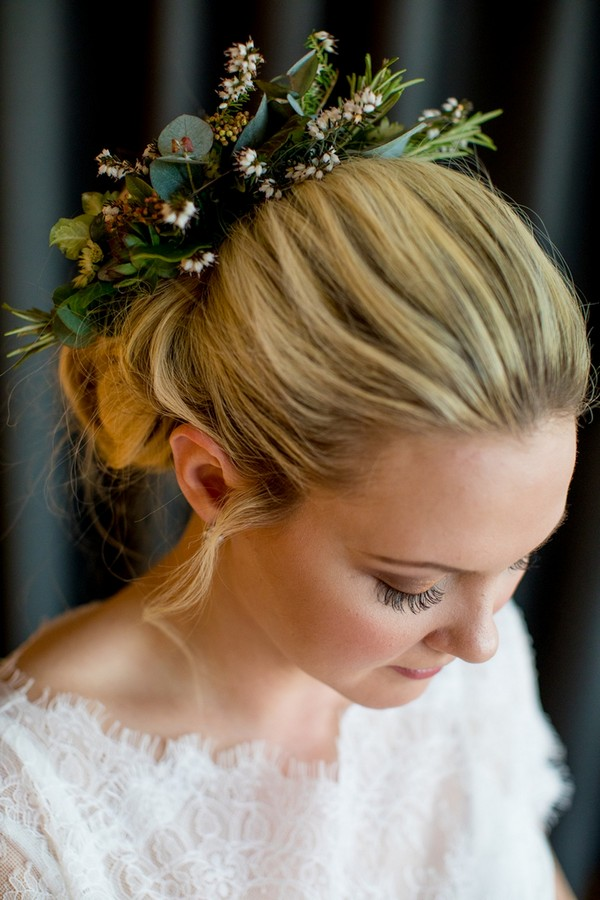 Bride with updo hairstyle with foliage in back