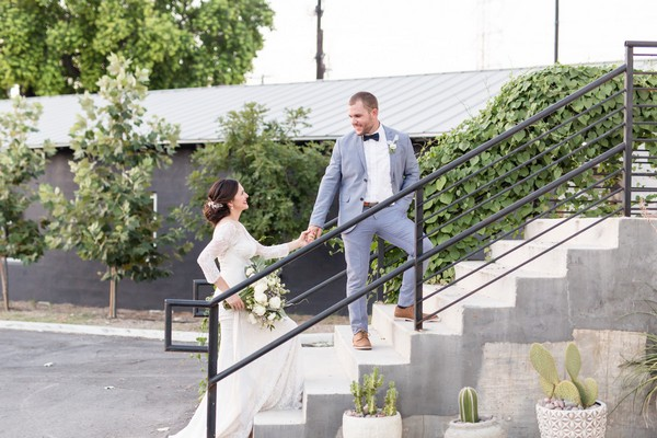 Bride and groom on steps of East Crossing