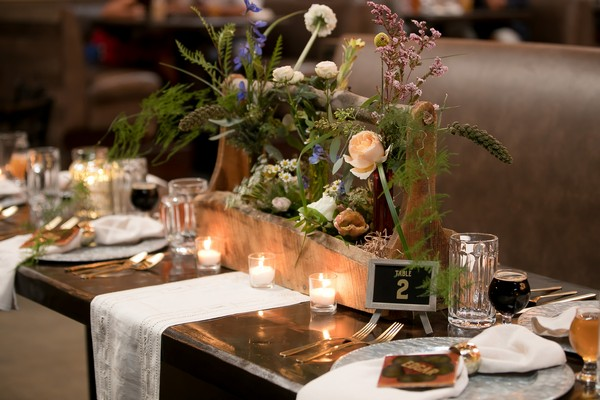 Floral wedding table centrepiece in wooden planter