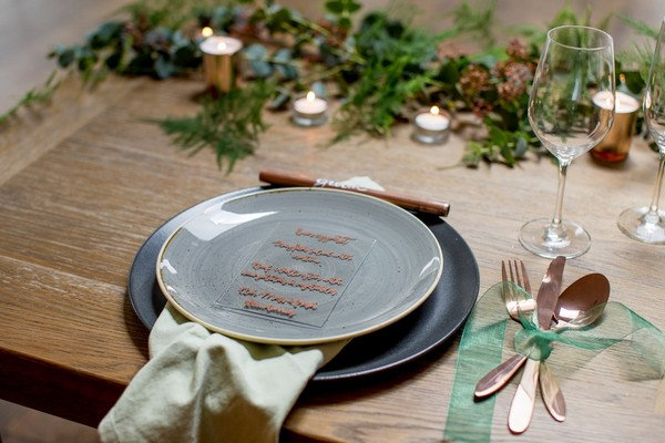 Grey wedding plate with glass menu and copper details